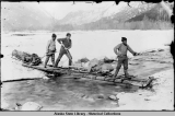 Photographer's equipment on sleds, crossing an icy river. ca. 1897.