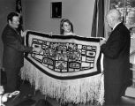 Governor Boucher and J. D. Cooper examine Chilkat robe, ca. 1970.