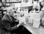 Bob DeArmond, signing copies of his book, ca. 1969.