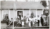 Children on porch of bakery, Port Alexander, Alaska.