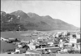 Looking over Juneau business district and waterfront toward the Douglas bridge, ca. 1935.