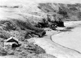 Aleutian Island beach, with wooden buildings, 1941.