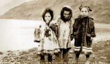 Three girls in parkas, Unalaska.