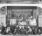 The cast and orchestra of a stage play, probably at The Opera House, Juneau, Alaska, ca. 1890.