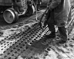 Runway repair, Naval Air Station, Adak, March 14, 1945.