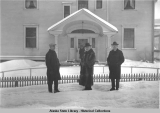 Governor Scott C. Bone (center) and two men in front of Governor's Mansion, Juneau.