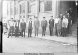 Staff of the DAILY ALASKA EMPIRE in front of the Empire Building on Main Street, Juneau.