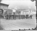 Juneau Fire Department on Front Street with hose cart, ca. 1890.