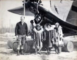 Noel Wien and three Inupiaq girls wearing parkas, ca. 1931.