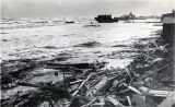 Debris along Nome shoreline after storm, 1913.