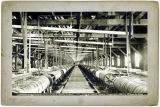 "Concentrator floor, A.U.G.M. Co.'s ""Ready Bullion"" Mill, Douglas Island, Alaska, c. 1899."
