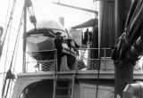 Sailor playing bugle on deck of Revenue Cutter BEAR.