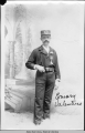 Emory [Emery] Valentine in fire fighter's uniform, ca. 1890.