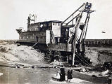 Gold mining dredge, Nome area.