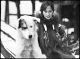Alaska Native girl with dog.