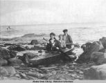 "Peter Kewan's bidarka on the ""Aleut Town"" beach, Afognak, Alaska, ca. 1910."