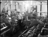 Man working in steamship engine room.