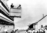 Mrs. Warren G. Harding disembarks from HENDERSON at Cordova, Alaska.