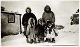 Eskimo mother, daughter, and grandchildren.