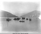 Fishing boats in Taku River with East Twin Glacier in background.