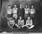 Juneau High School boys basketball team and coach N. I. Baker, 1924.
