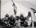 Eskimos from Wales camping on beach at Nome, Alaska.