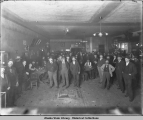 Crowd of men in gambling hall.