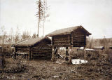 Log cabin and cache, Fort Egbert, 1899.