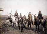 Hunters on horseback.