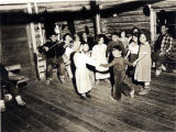 Athabascan children, dancing to fiddle music.