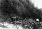 Blacksmith shop and ore house at mine, Sumdum, 1896.