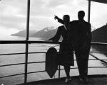 Silhouette of couple on steamship, Inside Passage, Alaska.