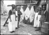 Six African American soldiers with three halibut.