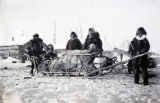 Koyukuk family with loaded sled in Allakaket, Alaska.