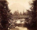 Foot bridge at Indian River, Sitka, ca. 1881.