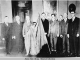 Governor Parks and seven men with Alaska flag, ca. 1927.