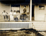 [Group lounging on a porch.]