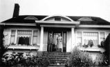 Willis [E. Nowell, Sr.] and Frances [Eletta Newton Nowell] in front of Willis's home in Edmonds,...