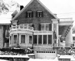 [Side view of Governor's Mansion in winter.]