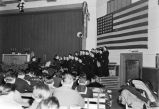 Midnight Mass on Christmas Eve, Dec. 24, 1943. [Choir or chorus in front of auditorium.]