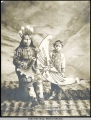 Mrs. Stene-Tu and son (Ravens) in potlatch dancing custome [costume].  Copyright 1906.