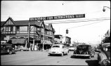 [Anchorage, Alaska.  Street scene with Hewitt's Drugs, Cheechako Tavern Cafe, and Anchorage Fur...