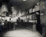 Treadwell store [interior; 3 men at long counter].
