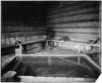 Mineral springs bathing pool.  Tenakee, Alaska [interior view].