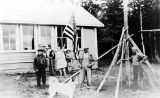 [Homer, Alaska, 1929.  Margaret and others raising the American flag in front of the school.]