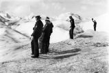 [British naval personnel standing on glacier.]