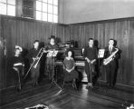 [A young sextet with instruments.]