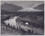 [View of Brotherhood bridge and farm scene with Mendenhall Glacier in background.]
