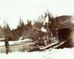 Donkey engine coming off scow at Eagle River, Alaska, 1899.
