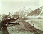 (James') sawmill, Douglas; Mt.  Juneau and Juneau at its base in background, 1899.